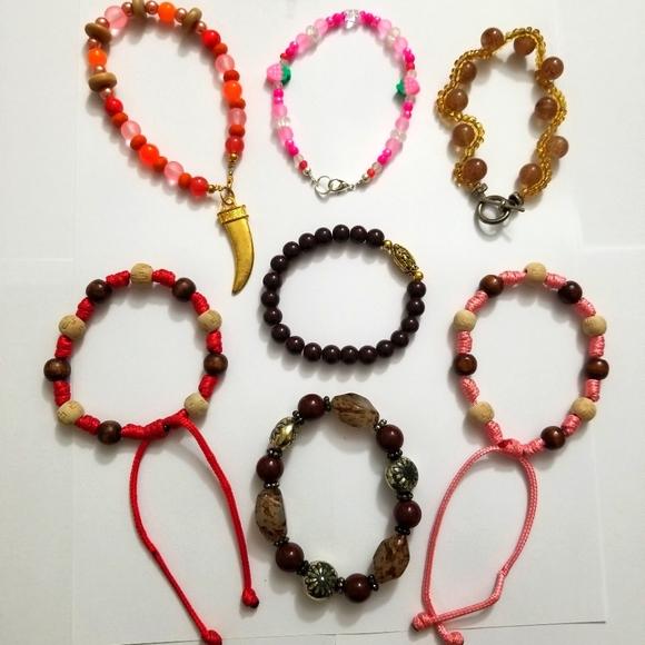 Used Bundle of Women Bracelets.  7 items